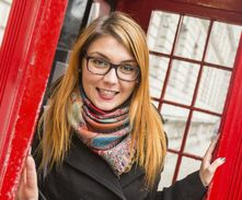 Young Woman next to London Traditional Telephone Booth
